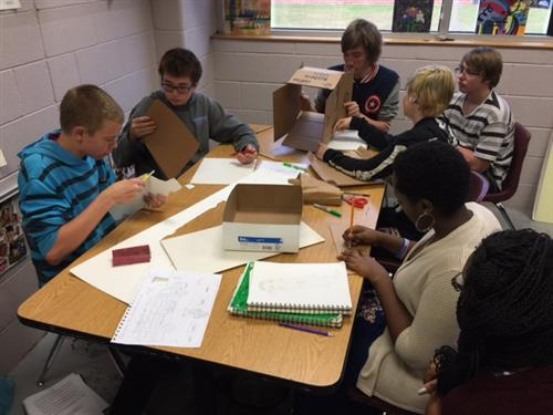 students working on cardboard designs