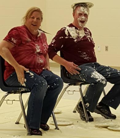 Mrs. Camden and Dr. Lutz recieve a pie in the face
